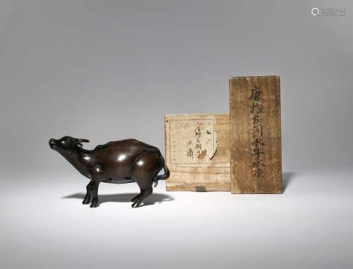 A CHINESE BRONZE 'WATER BUFFALO' WATER DROPPER 17TH CENTURY Formed as a standing water buffalo