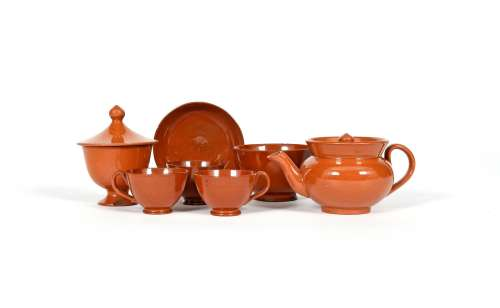 A glazed redware miniature part tea service, early 19th century, the lightly turned pieces decorated