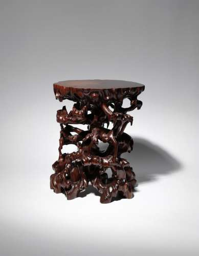A CHINESE HARDWOOD STAND 20TH CENTURY Naturalistically formed as many twisting gnarled tree
