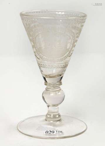 Translucent glass decorated with an engraved \