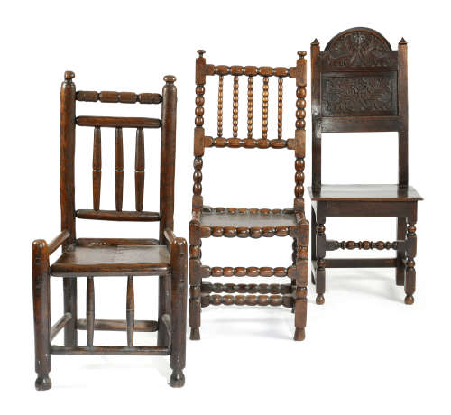 THREE COUNTRY CHAIRS LATE 17TH CENTURY AND LATER comprising: a bobbin turned chair with a solid