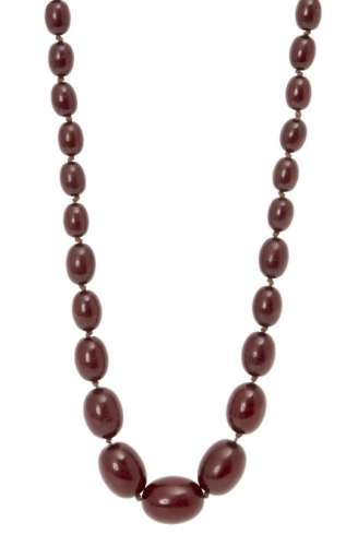 A cherry amber graduated bead necklace, late 19th century, consisting of forty-three oval beads, 1cm