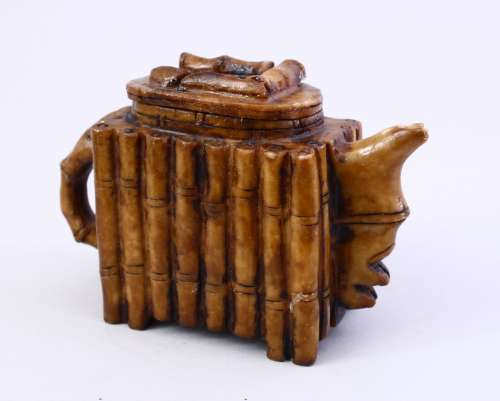 A CHINESE BAMBOO CARVED SOAP / HARD STONE TEA POT AND COVER, 10CM X 16CM.