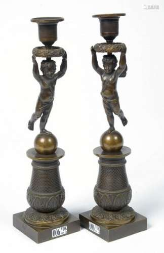 Pair of Empire style bronze candelabra with brown …