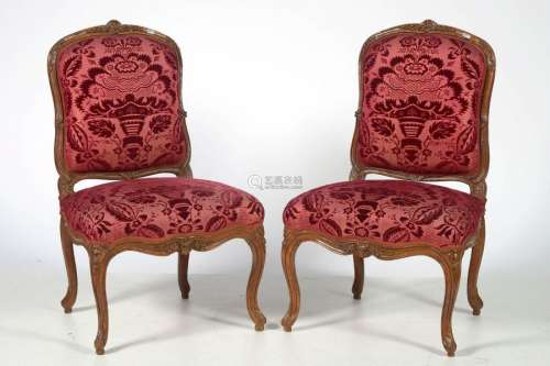 Pair of Louis XV style carved walnut chairs in car…