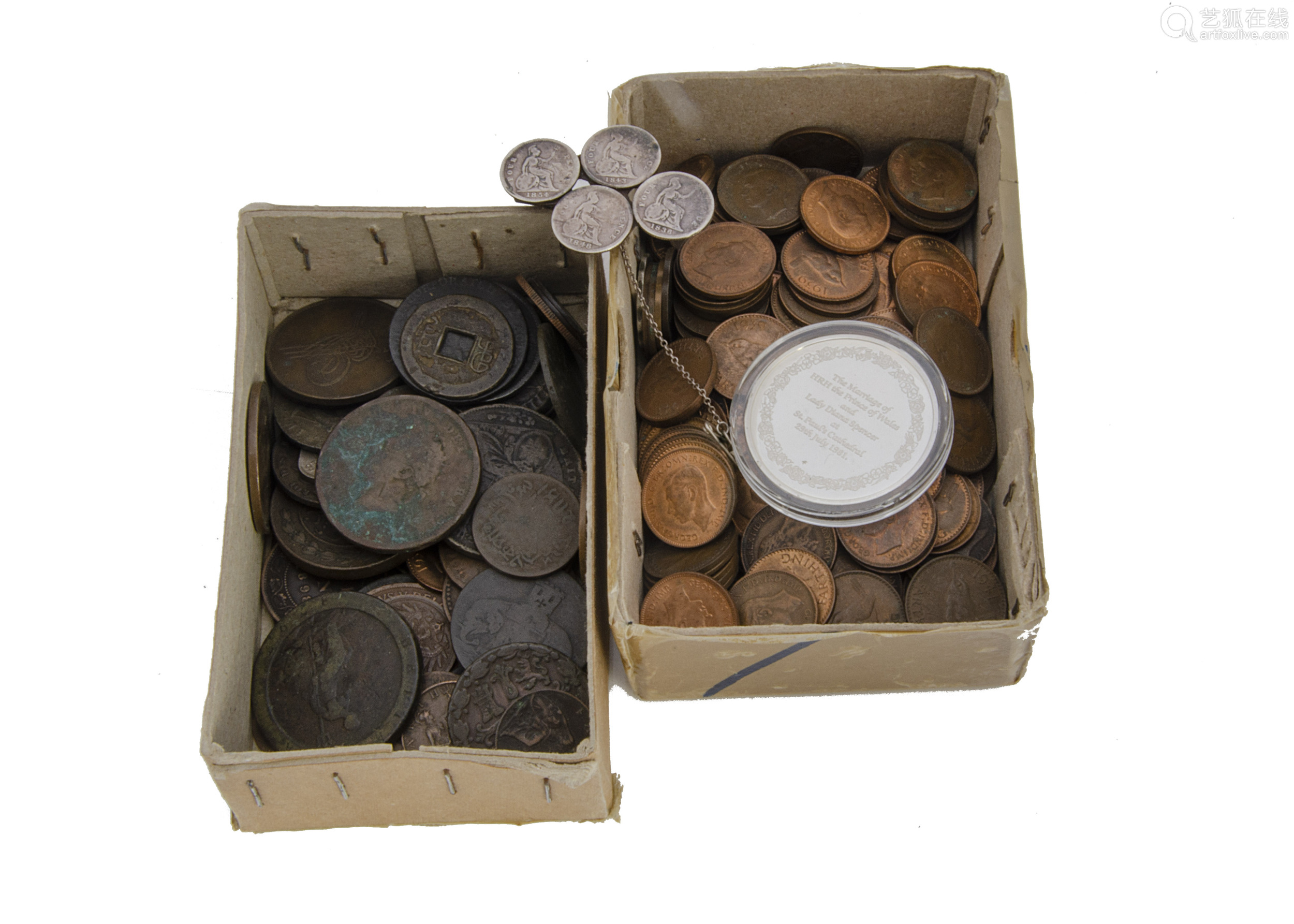 A small collection of coins, including a silver 1981 Charles & Diana commemorative medallion, and