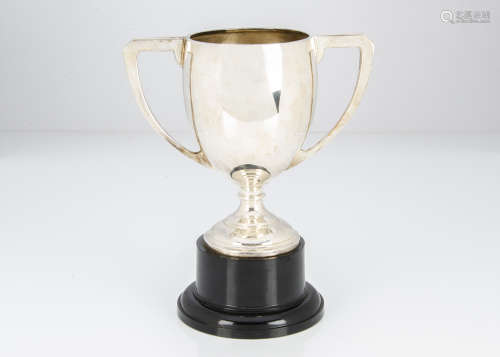 A George V period silver twin handled trophy cup, 10ozt, on black Bakelite style base, not engraved,