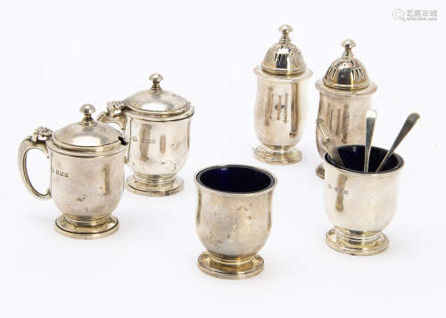 A late 1950s silver cruet set by Adie Bros, comprising a pair of salts, peppers and mustards, with