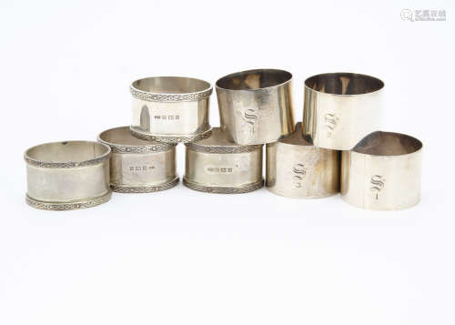 A set of four 1960s silver oval napkin rings from JR, together with a set of four silver napkin