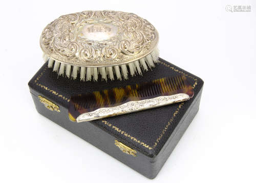 A cased 1960s silver mounted comb and clothes brush set