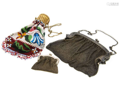 Three late 19th Century purses, one silver with mythical fish and bearin***arks, possibly French,