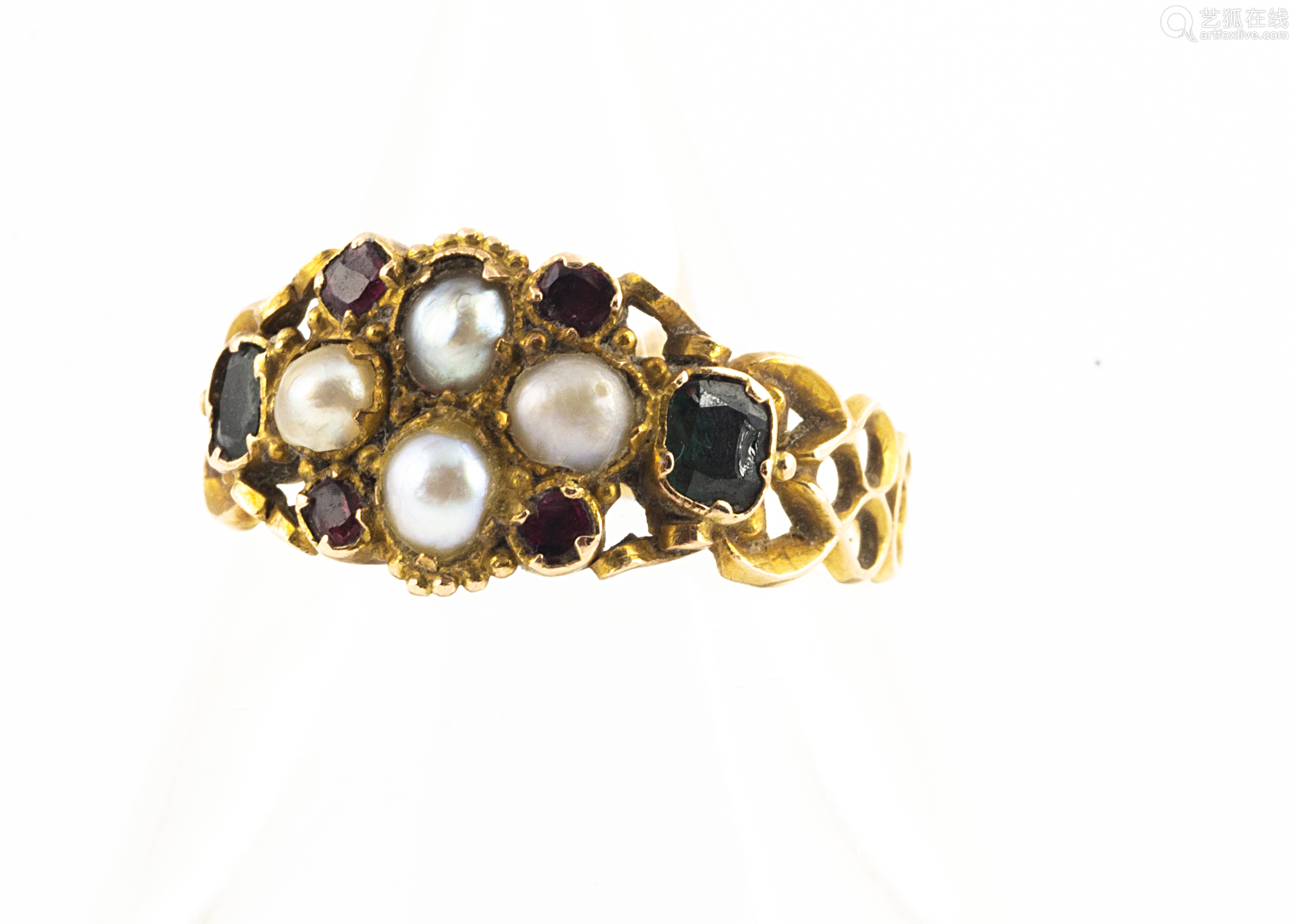 A yellow metal antique emerald, ruby and seed pearl posy ring, with pierced shoulders, engraved