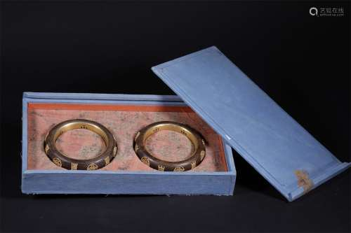 A PAIR OF QING DYNASTY AGILAWOOD BRACELETS INLAID WITH LONGEVITY