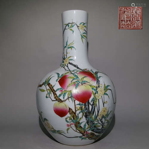 A QING DYNASTY FAMILLE ROSE PASTEL BOTTLE WITH NINE PEACHES