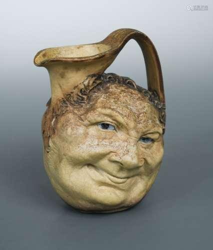 Robert Wallace Martin for Martin Brothers, a stoneware face jug, 1900,