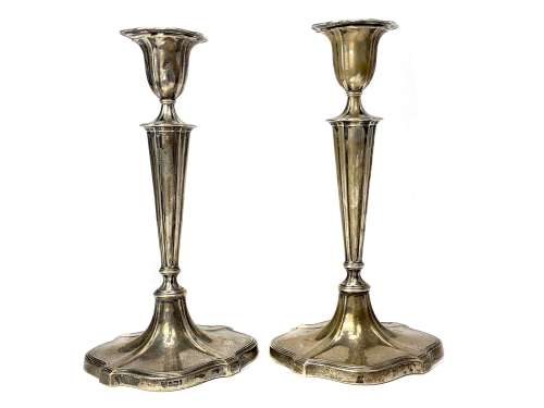 A SET OF FOUR TABLE CANDLESTICKS OF NEOCLASSICAL DESIGN