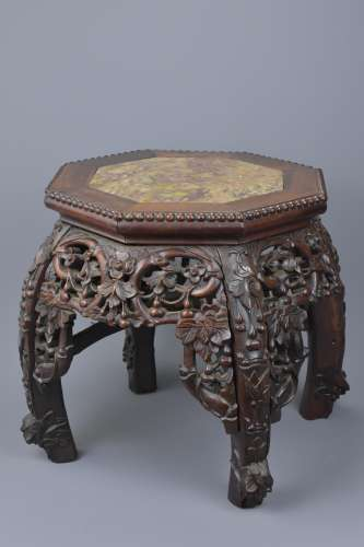 A Chinese 19th C. hardwood stand with marble top