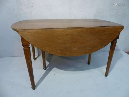 Round walnut table with extension and folding end.…