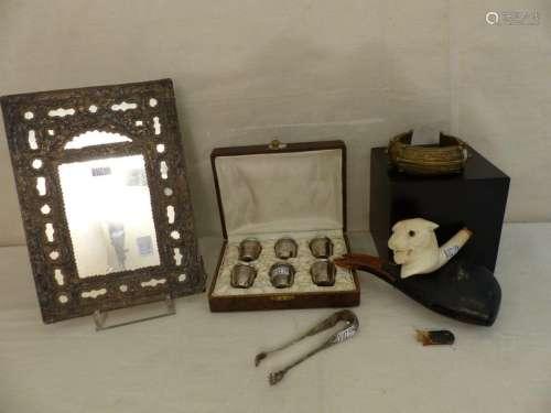 A silver ottoman mirror, 6 cups, a silver clip, a …