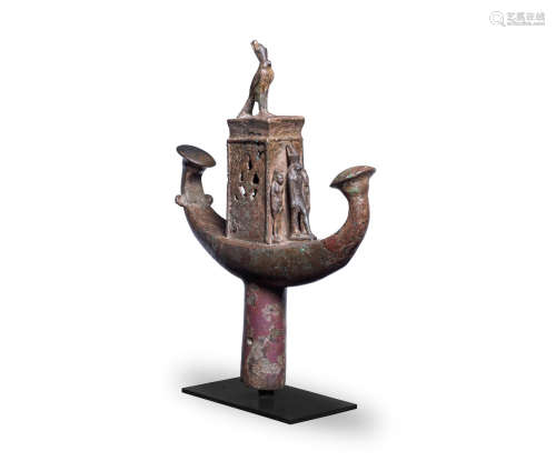 An Egyptian bronze solar boat finial