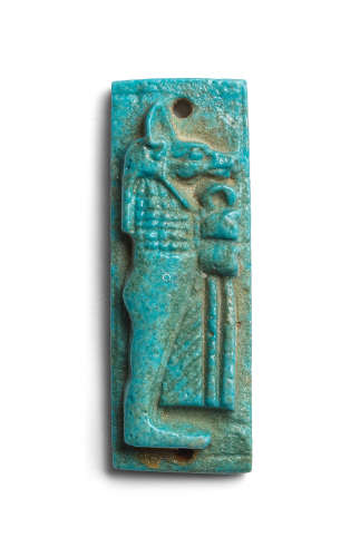 An Egyptian turquoise glazed composition plaque of Duamutef
