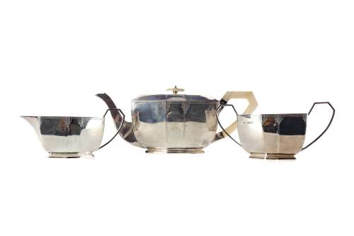 A SILVER THREE PIECE TEA SERVICE
