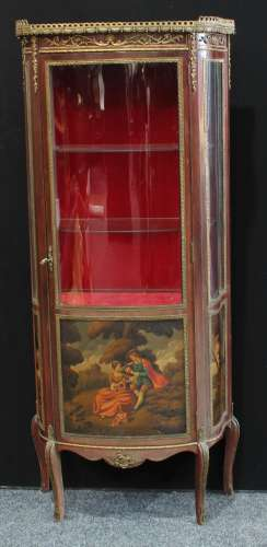 A Louis XV style gilt metal mounted mahogany shaped serpentine vitrine, pierced gallery above a