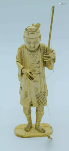 A small Japanese Meiji Period bone figure of a