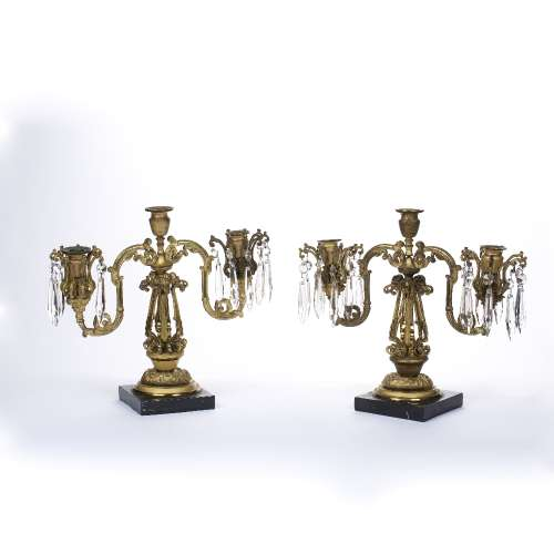 Pair of table two branch candelabra 19th Century, probably French, each on a marble base, with