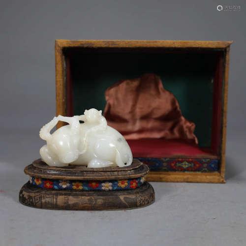 A WHITE JADE CATTLE ORNAMENT