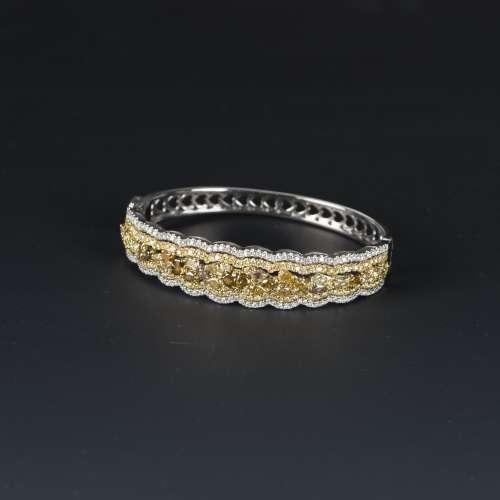 A FANCY COLOR DIAMOND BANGLE BRACELET, AIGL CERTIFIED