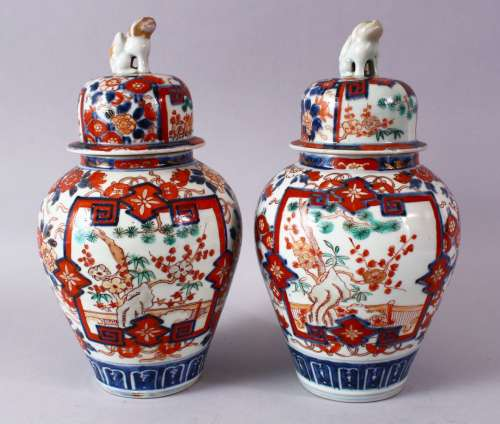A PAIR OF MEIJI PERIOD IMARI VASES AND COVERS, with kylin finials, overall 30cm high.