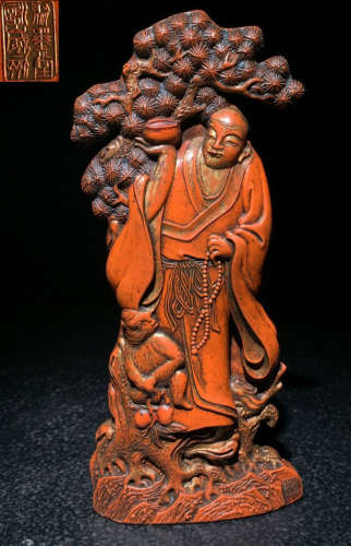 CINNABAR PENDANT CARVED WITH FIGURE