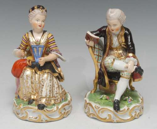 A pair of early 19th century Derby figures, Boy Reading a Bo...