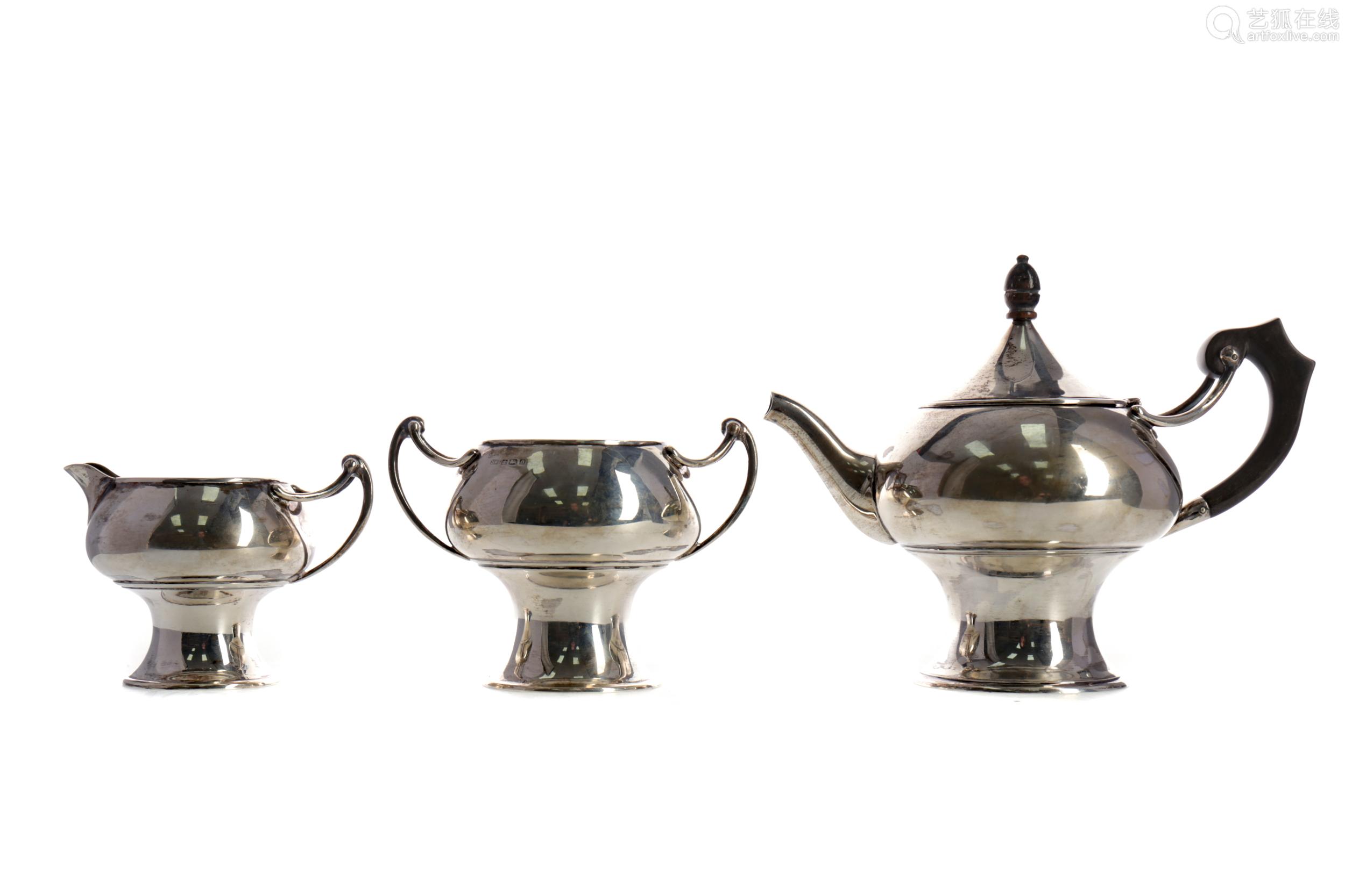 AN EDWARDIAN ART NOUVEAU SILVER BACHELOR'S THREE PIECE TEA S...