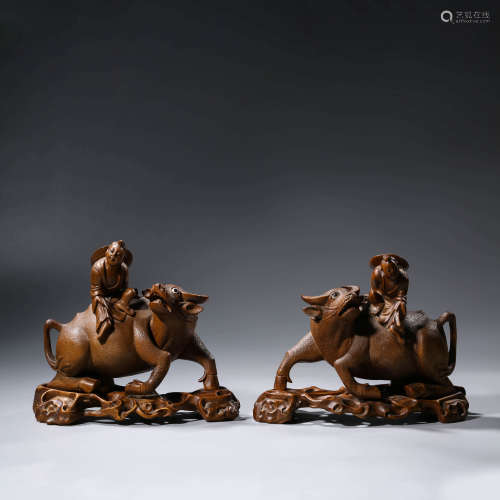 A PAIR OF CHINESE WOODEN BULLS AND CHILDREN