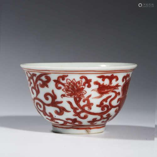 A CHINESE PORCELAIN  IRON-RED GLAZED PHOENIX BOWL