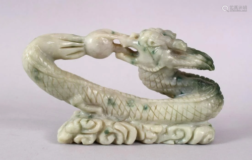 A CHINESE CARVED SOAPSTONE FIGURE OF A DRAGON…