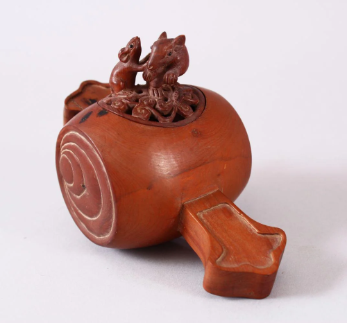 A JAPANESE CARVED WOODEN CARVED KORO, carved in…