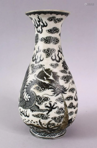 A CHINESE PORCELAIN DRAGON VASE, the dragon amongst
