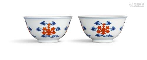 A fine pair of underglaze-blue and iron-red 'lotus' cups Sea...