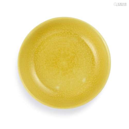 A yellow-glazed dish Mark and period of Zhengde | 明正德 黃釉...