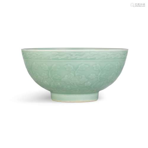 A moulded and incised celadon-glazed 'herbaceous peony' bowl...