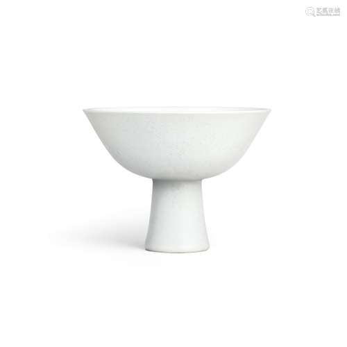 A fine white-glazed anhua-decorated 'lotus' stem bowl Mark a...