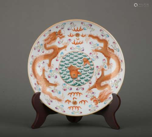 A allite red glazed 'dragon' dish painting in gold
