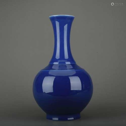 A blue glazed bottle