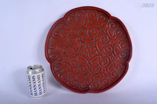 A 19TH CENTURY CHINESE CARVED TIXI LACQUER LOBED DISH
