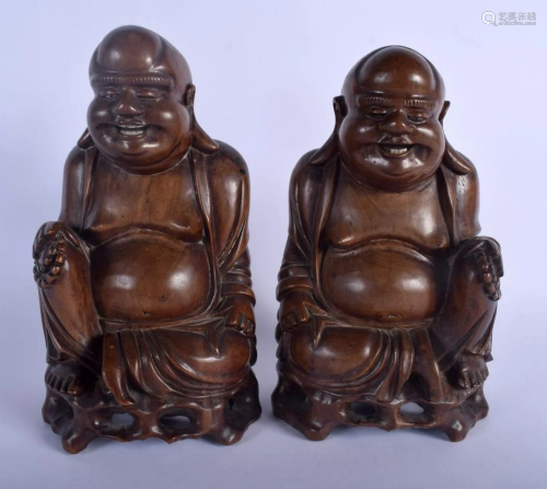 A PAIR OF 19TH CENTURY CHINESE CARVED HARDWOOD FIG…
