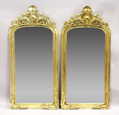 A PAIR OF GILT RECTANGULAR UPRIGHT MIRRORS with scroll