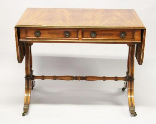 A REGENCY STYLE MAHOGANY SOFA TABLE by E.G. H…